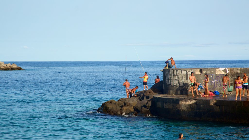 Santa Cruz de Tenerife which includes rocky coastline and fishing as well as a large group of people