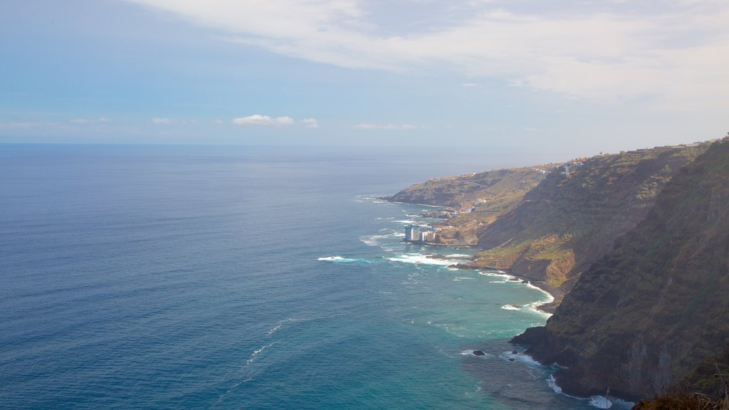 Sauzal which includes mountains, general coastal views and rocky coastline