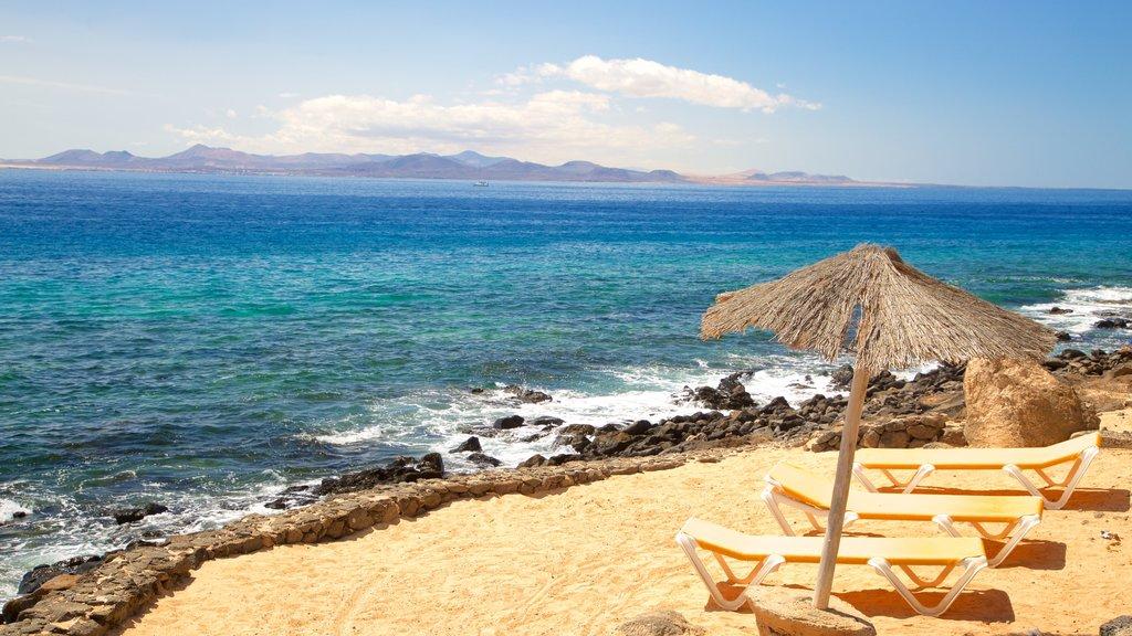 Playa Blanca showing a sandy beach and general coastal views