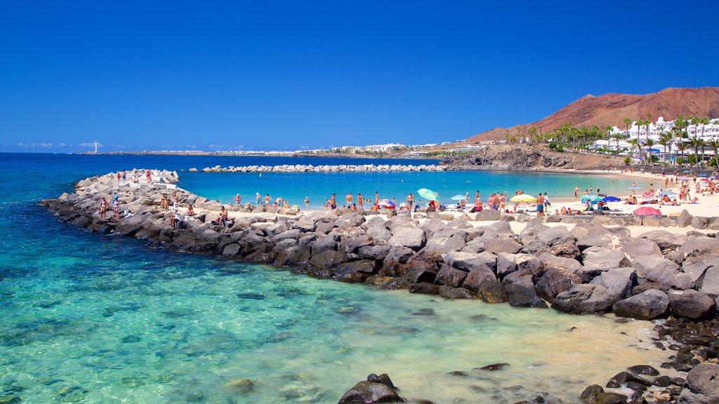 Playa Blanca which includes general coastal views and a beach