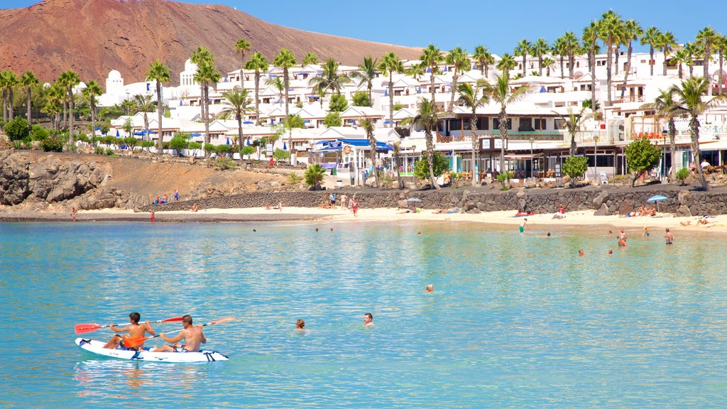 Playa Blanca showing kayaking or canoeing, a coastal town and swimming