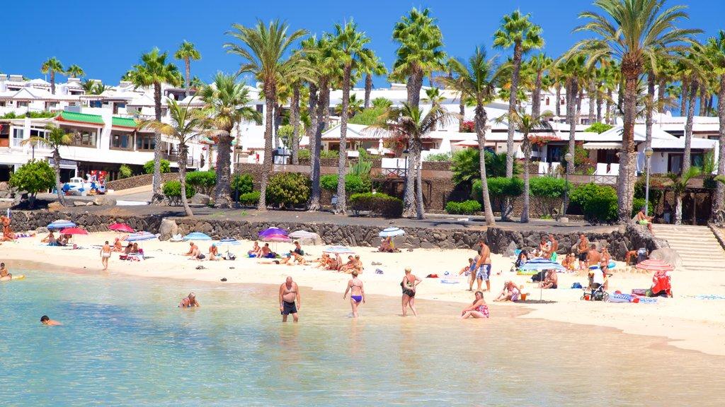 Playa Blanca featuring general coastal views, a beach and a coastal town
