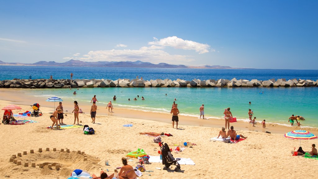 Playa Blanca which includes a beach, general coastal views and swimming