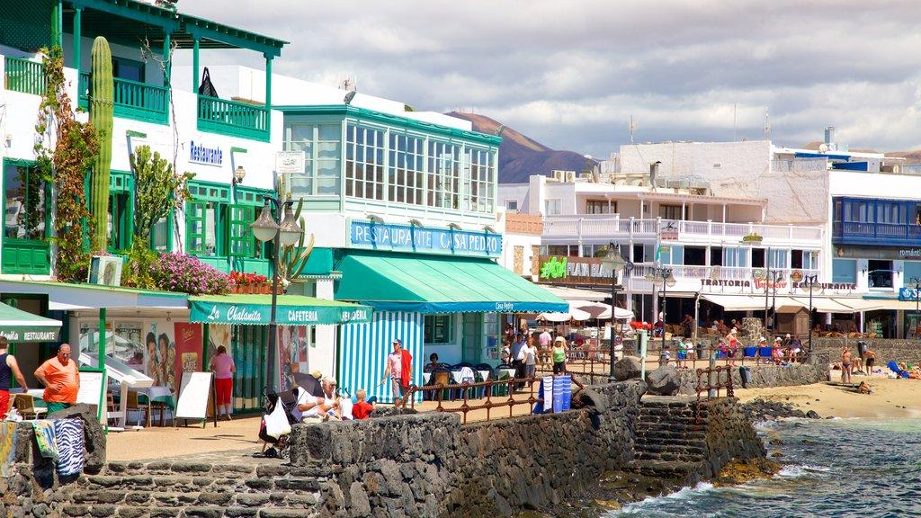 Playa Blanca featuring a coastal town and a sandy beach