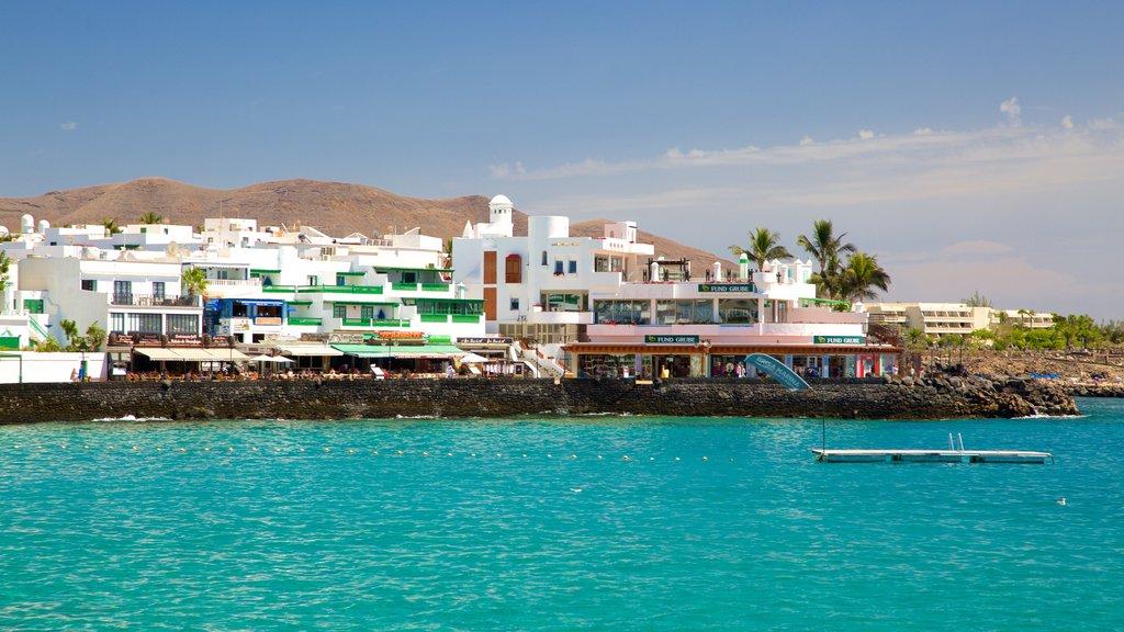 Playa Blanca which includes a coastal town, a beach and general coastal views