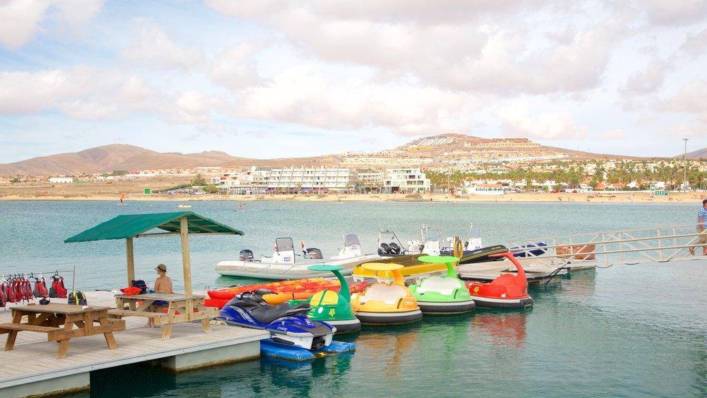 Caleta de Fuste which includes a bay or harbor, boating and general coastal views