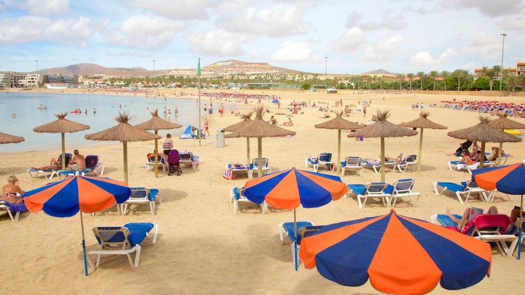 Caleta de Fuste featuring a luxury hotel or resort and a sandy beach
