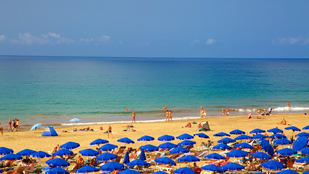 Meloneras showing a beach and general coastal views