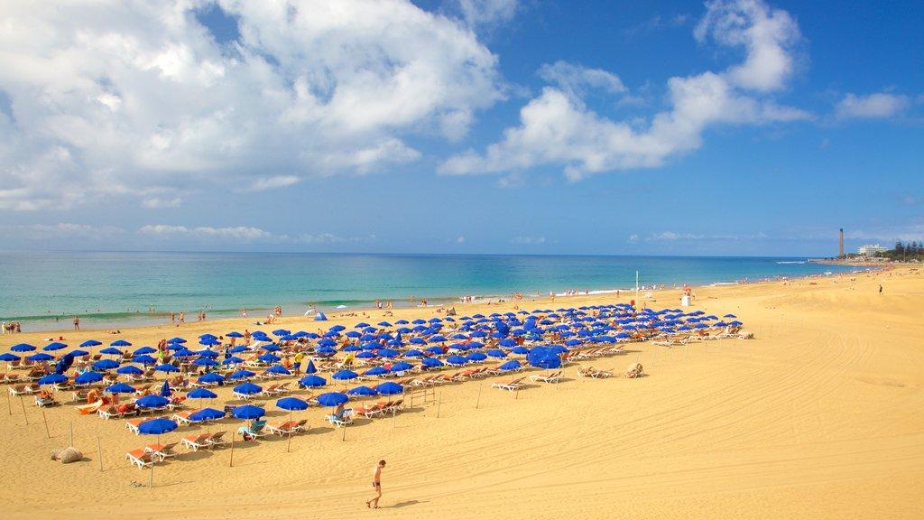 Meloneras featuring general coastal views and a sandy beach