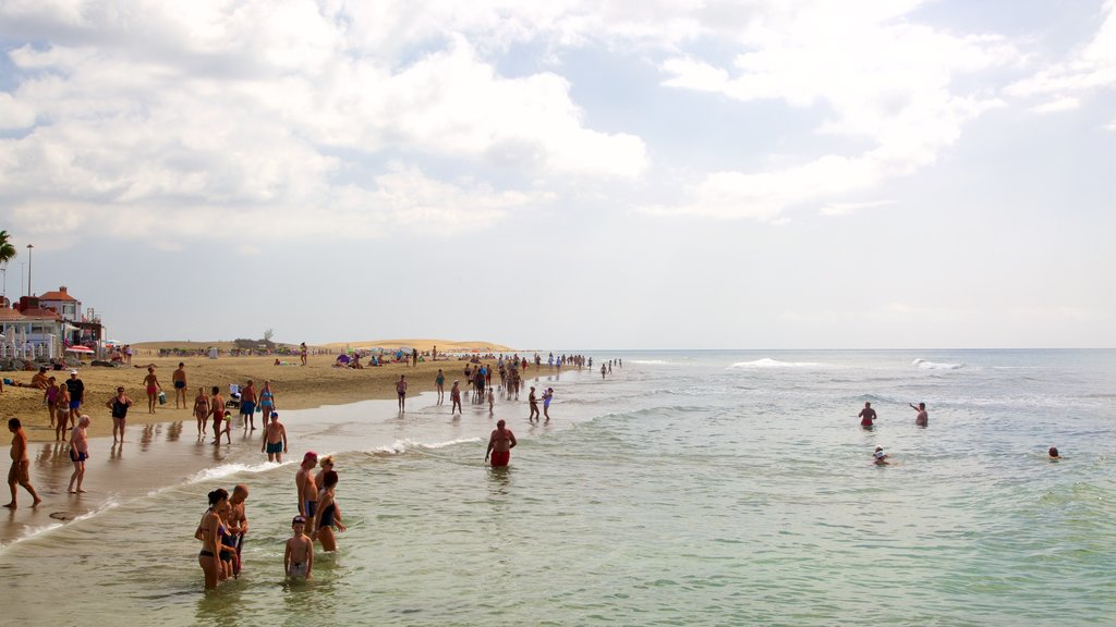 Meloneras which includes general coastal views, a sandy beach and swimming