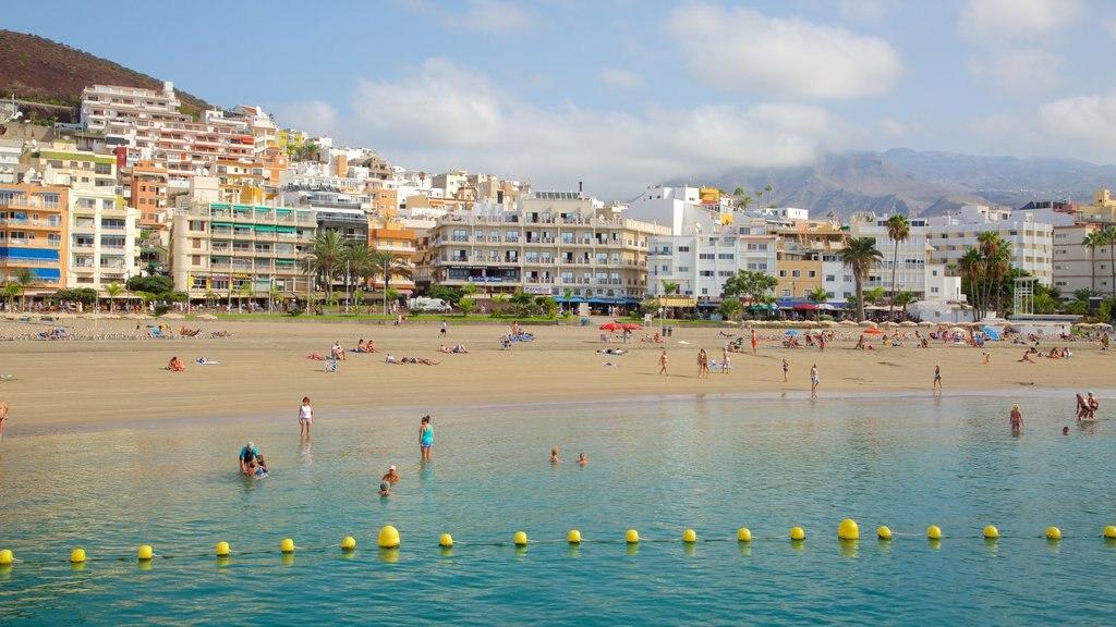 Los Cristianos showing a coastal town, general coastal views and a beach