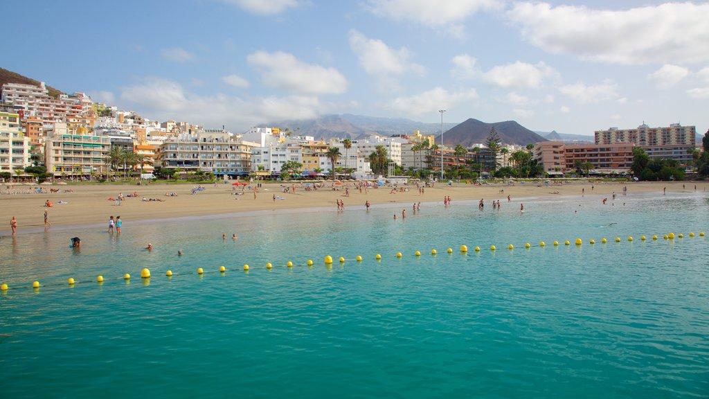 Los Cristianos which includes a sandy beach, general coastal views and a coastal town