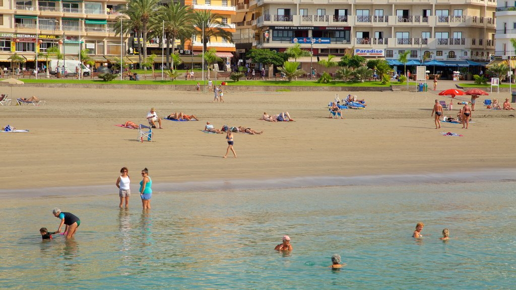 Los Cristianos featuring swimming, general coastal views and a beach