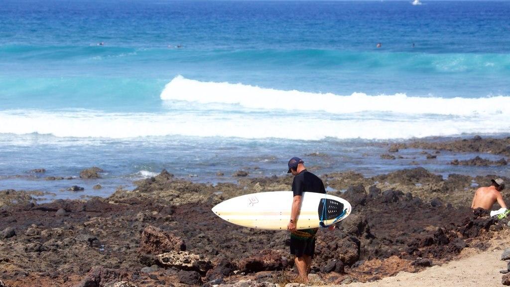 Playa de las Americas showing waves, rocky coastline and surfing