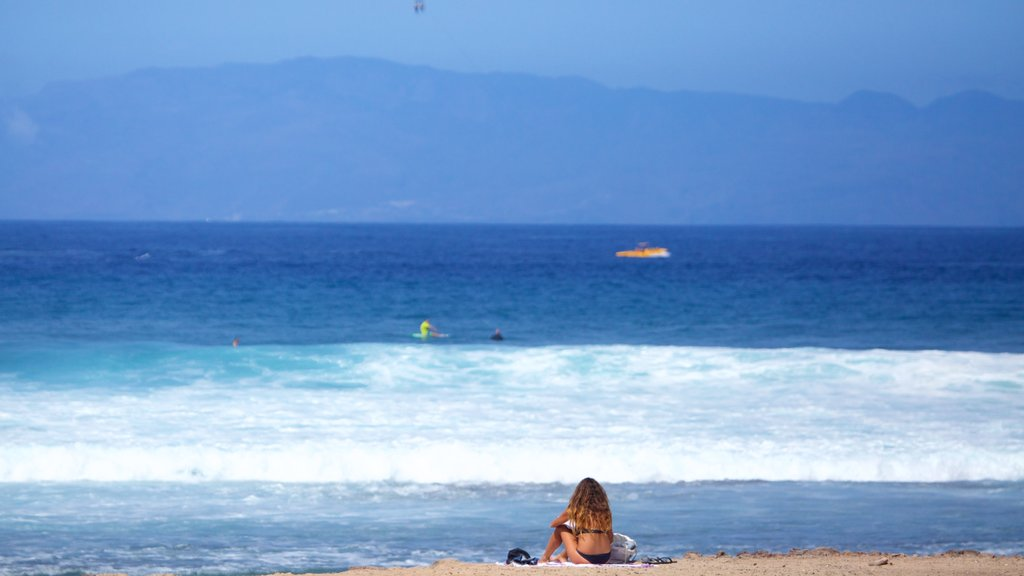Playa de las Americas featuring general coastal views and kayaking or canoeing as well as an individual femail
