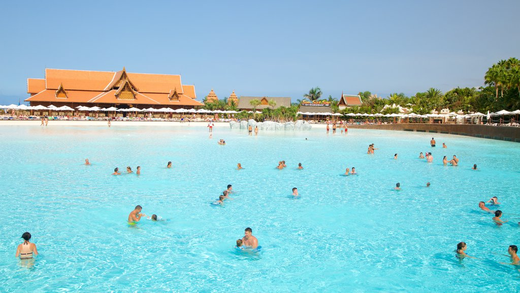 Siam Park featuring a waterpark and swimming as well as a large group of people