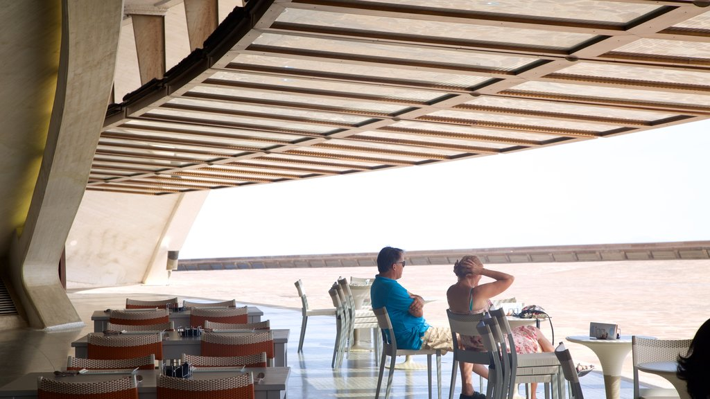 Auditorio de Tenerife showing cafe scenes as well as a couple
