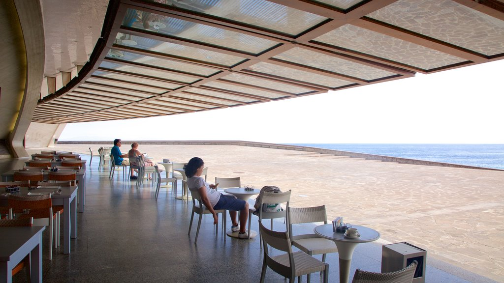 Auditorio de Tenerife featuring general coastal views and cafe lifestyle as well as a couple