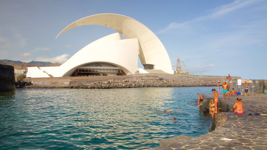 Auditorio de Tenerife showing modern architecture, general coastal views and swimming