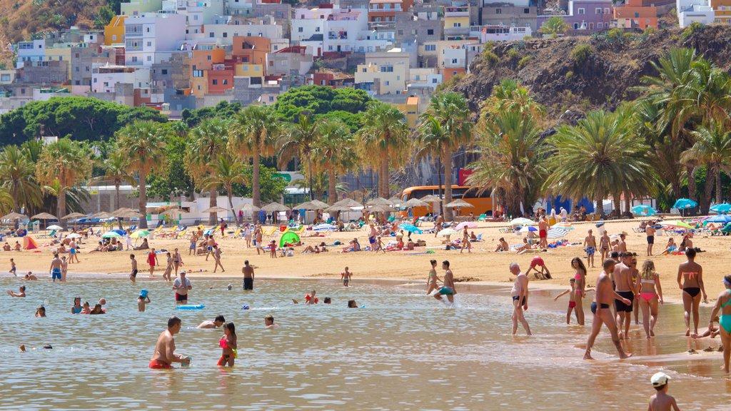 Teresitas Beach which includes general coastal views, swimming and a sandy beach