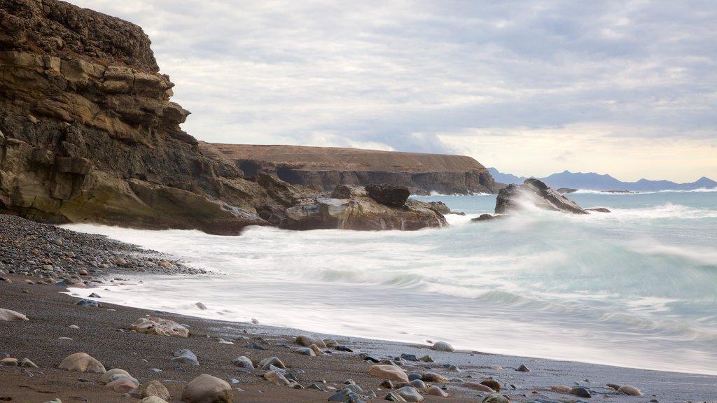 Ajuy Beach which includes surf, rocky coastline and general coastal views