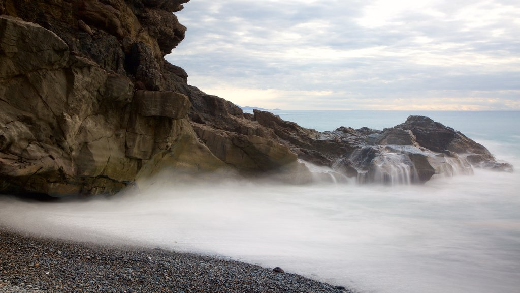 Ajuy Beach showing mist or fog, general coastal views and rocky coastline