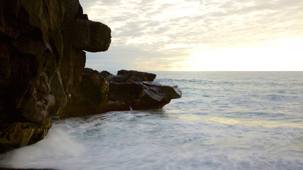 Ajuy Beach which includes rugged coastline, general coastal views and a sunset