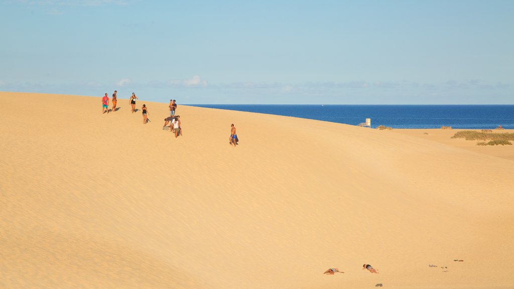 La Oliva which includes a sandy beach as well as a small group of people