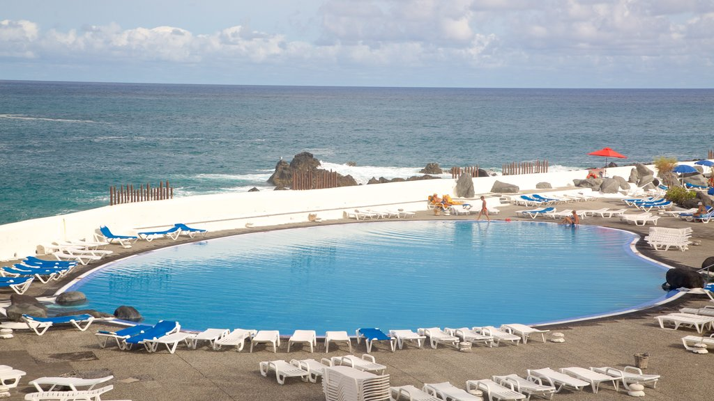 Lago Martianez Swimming Pools showing a luxury hotel or resort and a pool