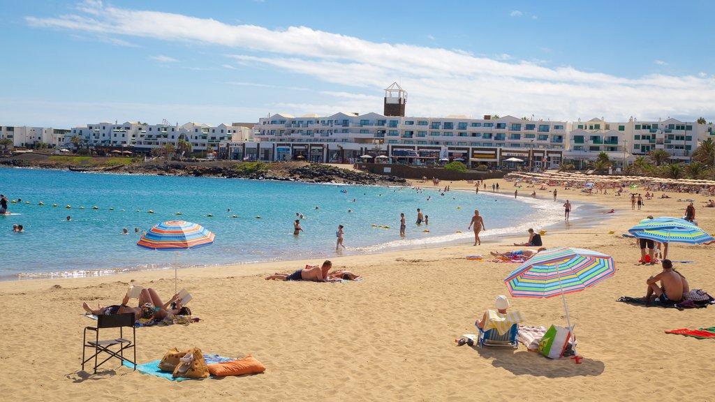 Las Cucharas Beach showing a beach, swimming and general coastal views