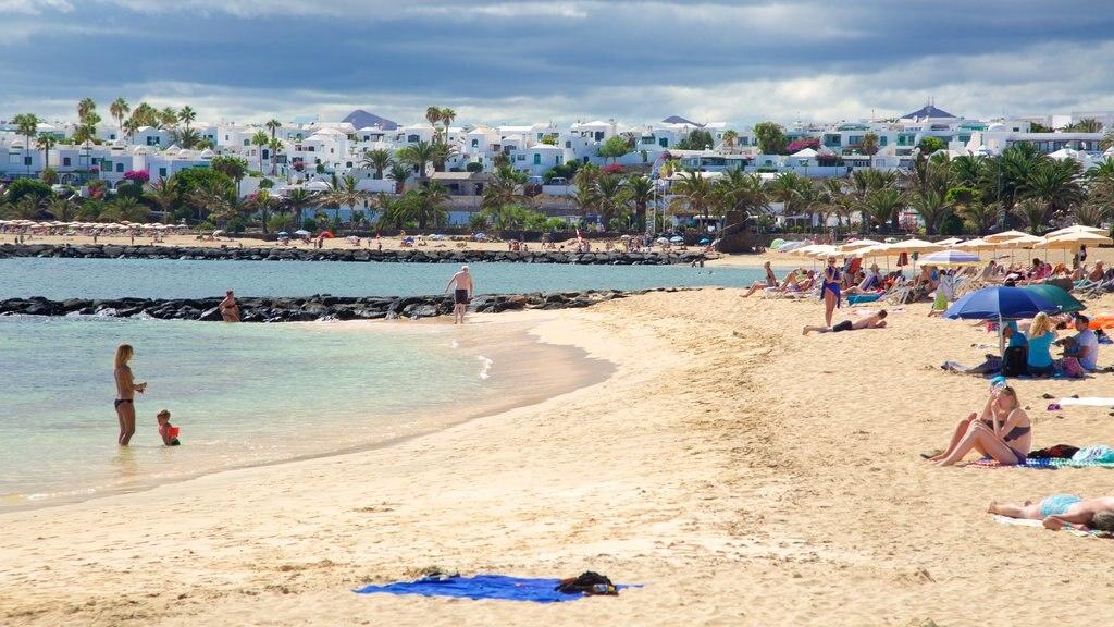 Las Cucharas Beach featuring a coastal town, general coastal views and a sandy beach