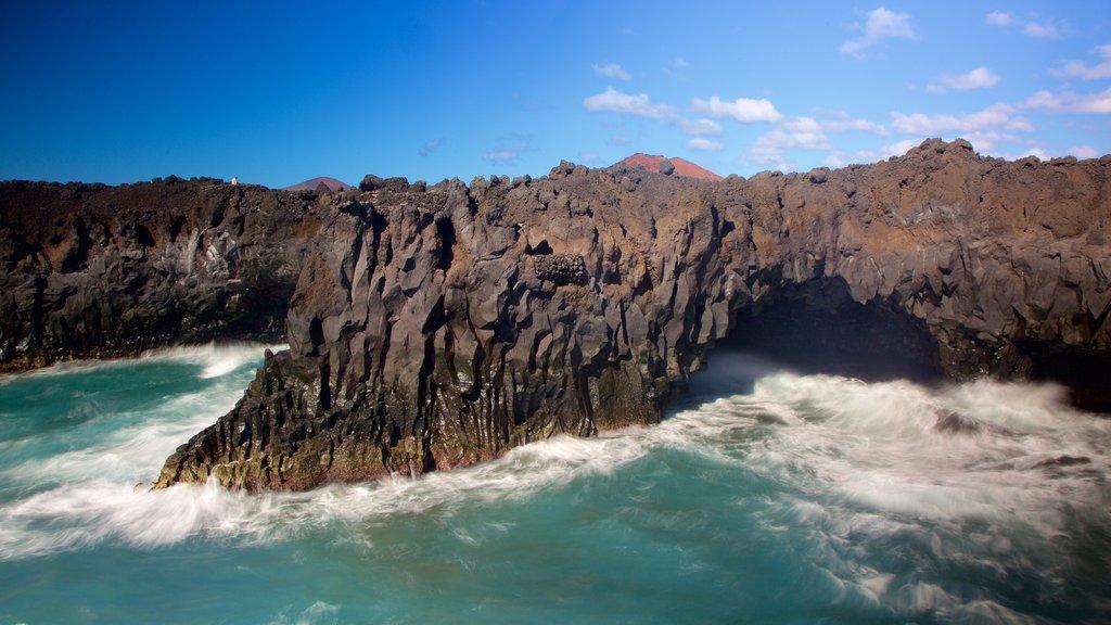 Los Hervideros Caves which includes rugged coastline