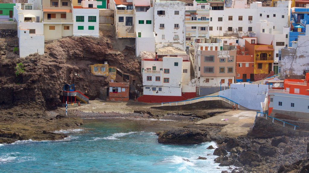 Gran Canaria featuring general coastal views, rugged coastline and a pebble beach
