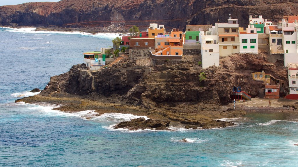 Gran Canaria featuring a coastal town, a pebble beach and general coastal views