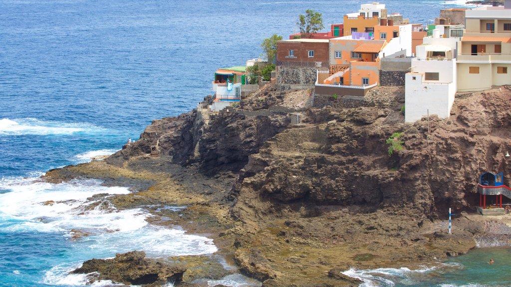 Gran Canaria which includes general coastal views, a pebble beach and a coastal town