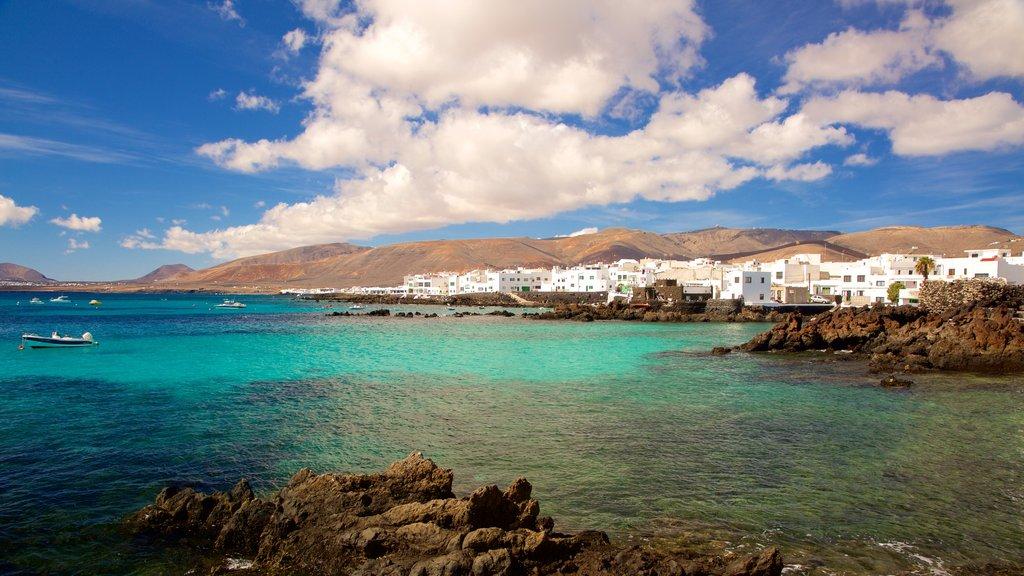 Lanzarote featuring general coastal views, a coastal town and rugged coastline