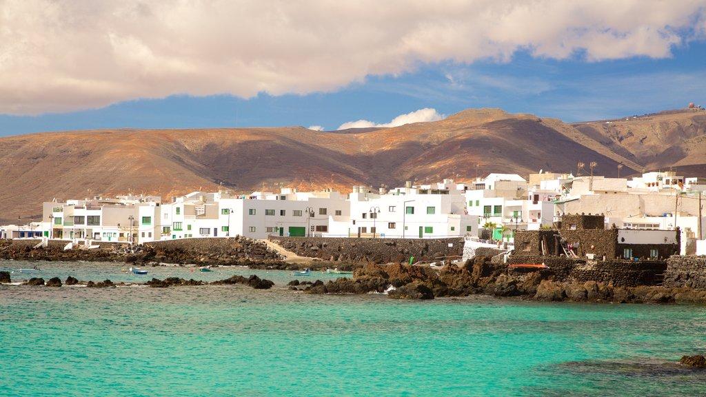 Lanzarote featuring a coastal town, rugged coastline and general coastal views