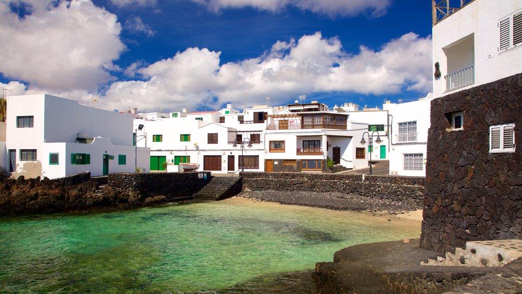 Lanzarote featuring rocky coastline, general coastal views and a coastal town