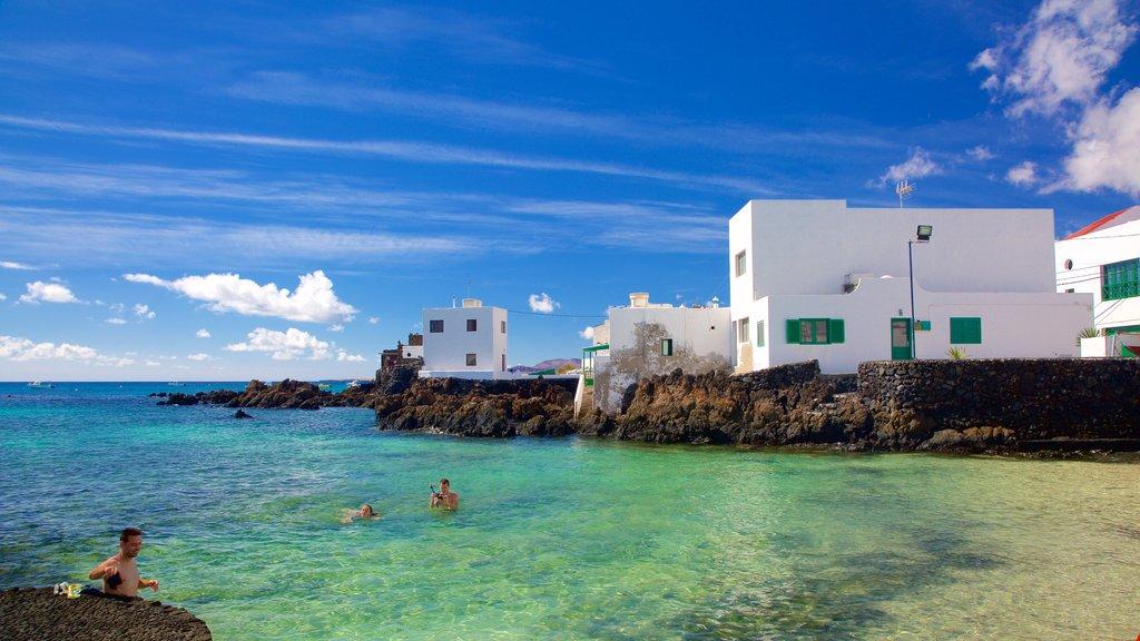 Lanzarote which includes rocky coastline, general coastal views and a coastal town