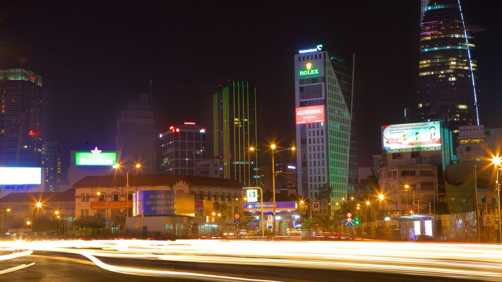 Pham Ngu Lao Street which includes night scenes and skyline