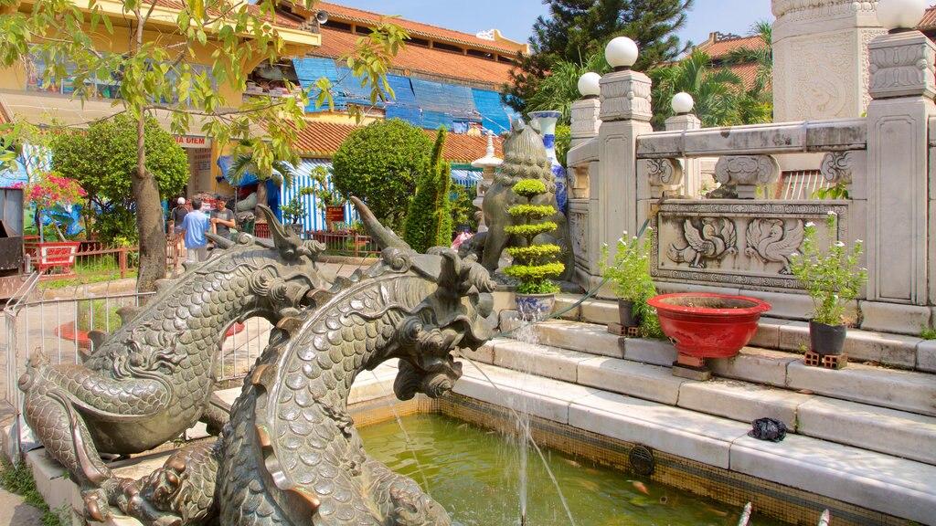 Cholon featuring a garden and a fountain