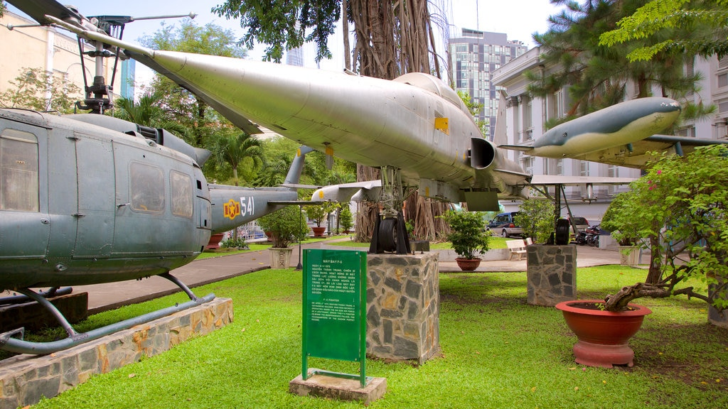 Ho Chi Minh City Museum showing military items, a garden and aircraft