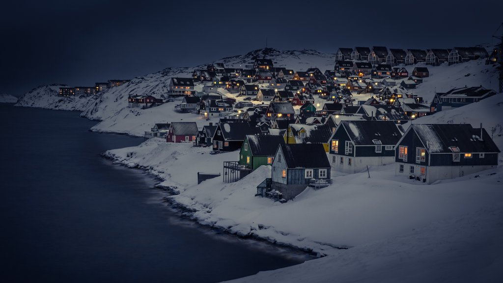 Nuuk featuring snow, mountains and a small town or village