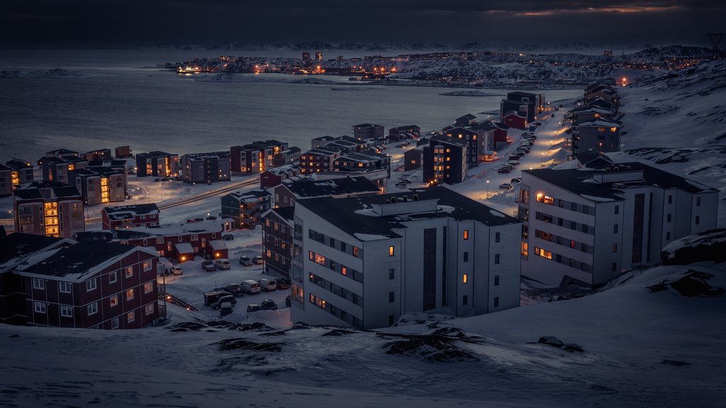 Nuuk featuring snow, a city and night scenes