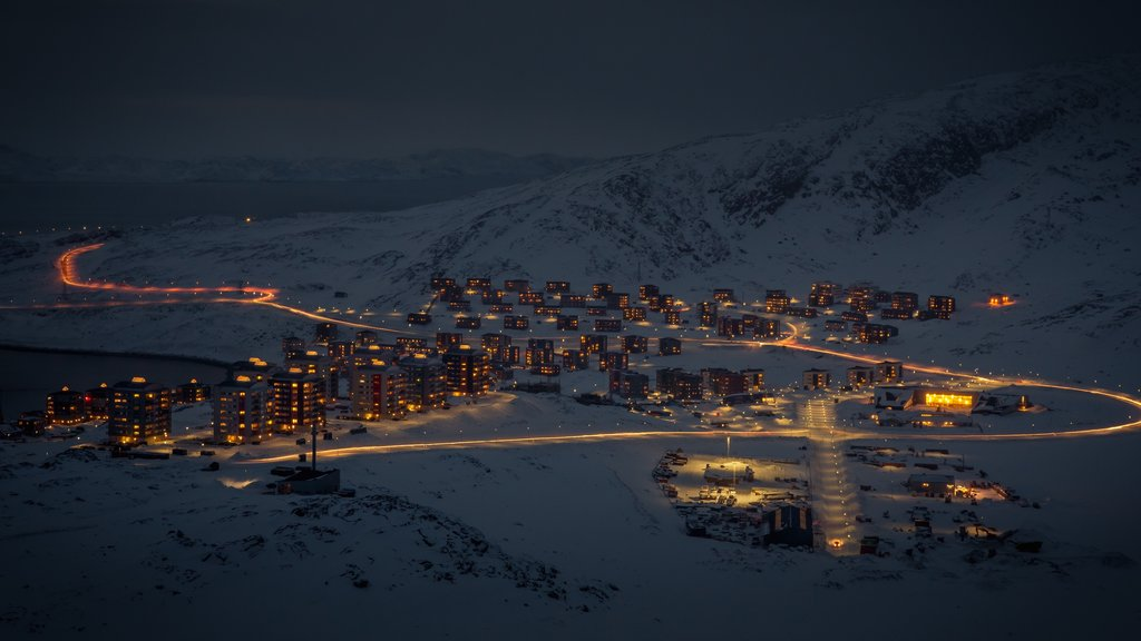 Nuuk featuring snow, night scenes and a city