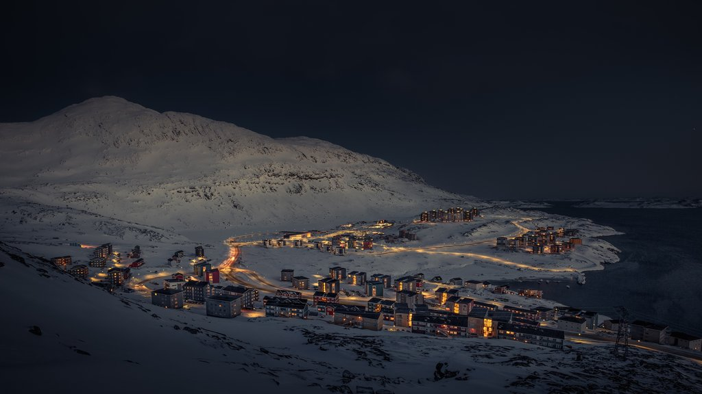 Nuuk featuring a city, mountains and night scenes