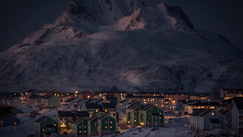 Nuuk featuring mountains, night scenes and snow