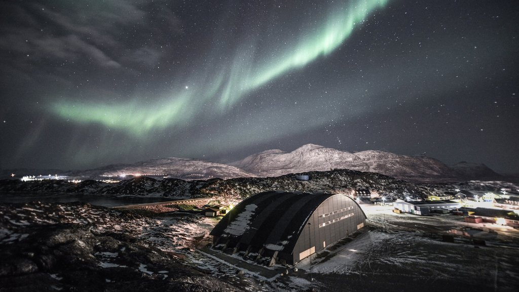 Nuuk which includes snow, northern lights and mountains