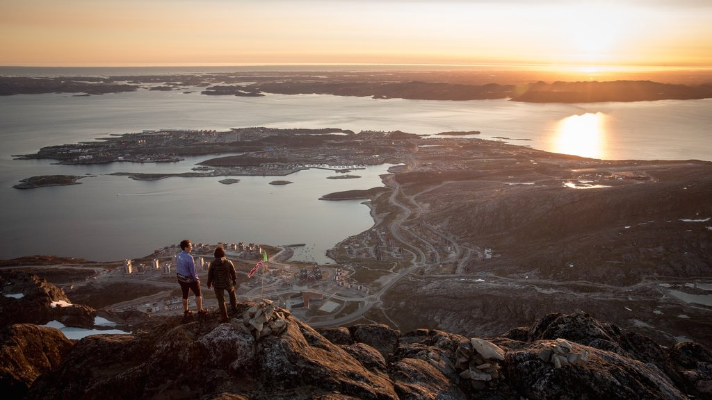 Nuuk which includes a city, a sunset and a lake or waterhole