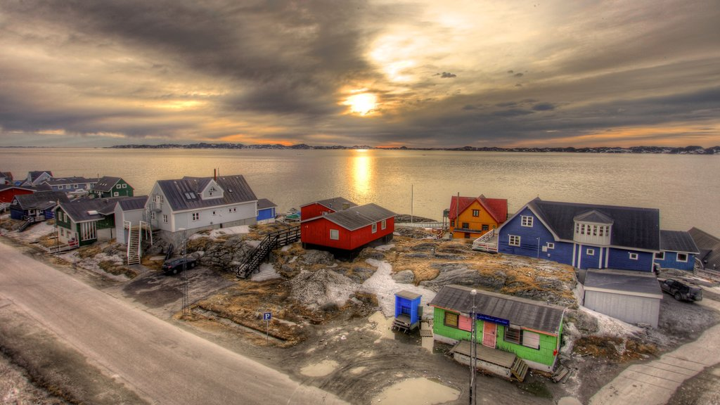 Nuuk showing a small town or village, a sunset and a lake or waterhole